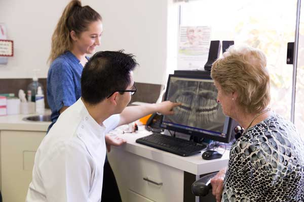 Dentist and patient viewing dental xray